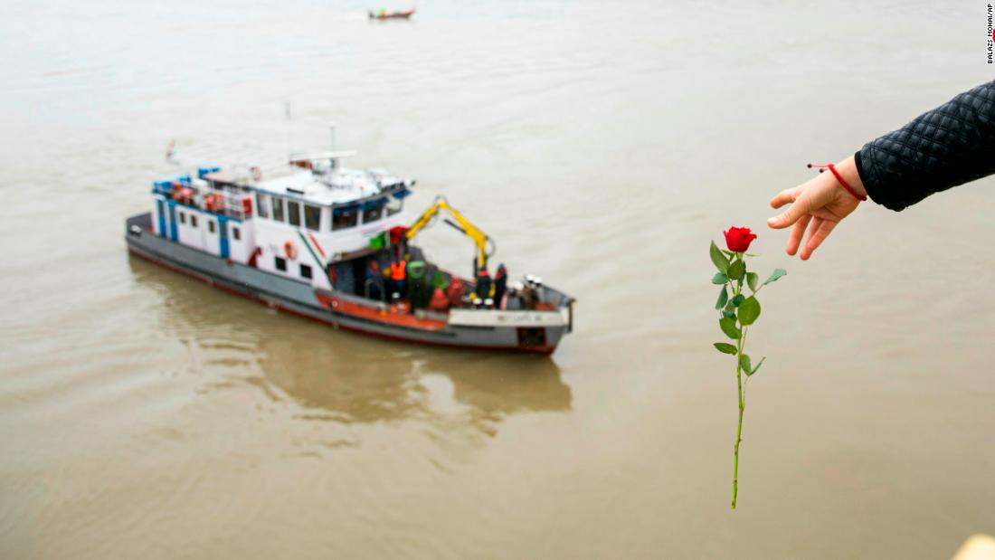 "A woman in Budapest, Hungary, throws a flower from the Margaret Bridge during a search operation on the Danube river on Thursday, May 30. A <a href=""https://www.cnn.com/2019/05/29/europe/hungary-sightseeing-boat-sinks-on-danube-river/index.html"" target=""_blank"">riverboat collision</a> killed at least seven people and left 21 missing.<br />"