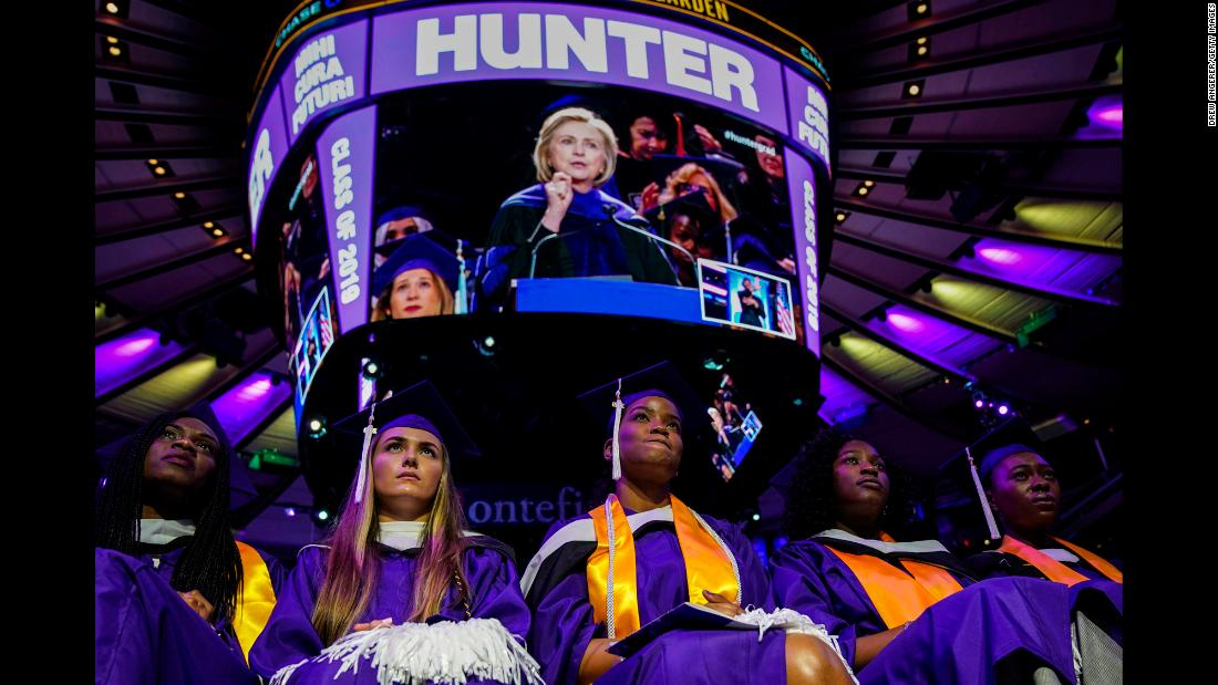 Hunter College graduates listen to former Secretary of State Hillary Clinton, who was delivering their commencement address in New York on Wednesday, May 29.