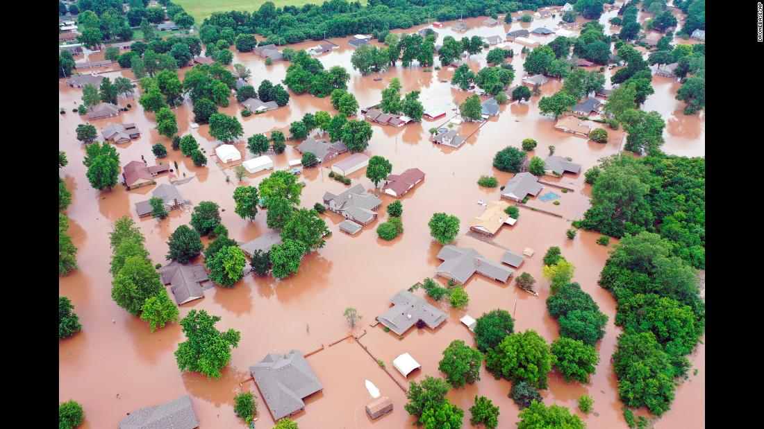 "This aerial photo, taken on Tuesday, May 28, shows flooded homes along the Arkansas River in Sand Spring, Oklahoma. All 77 of Oklahoma's counties were under a state of emergency Tuesday because of <a href=""https://www.cnn.com/2019/05/29/us/tulsa-floods-drones-helicopters-trnd/index.html"" target=""_blank"">historic flooding. </a>"