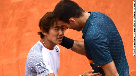 Juan Martin del Potro (right) and Yoshi Nishioka played a thriller at the French Open.