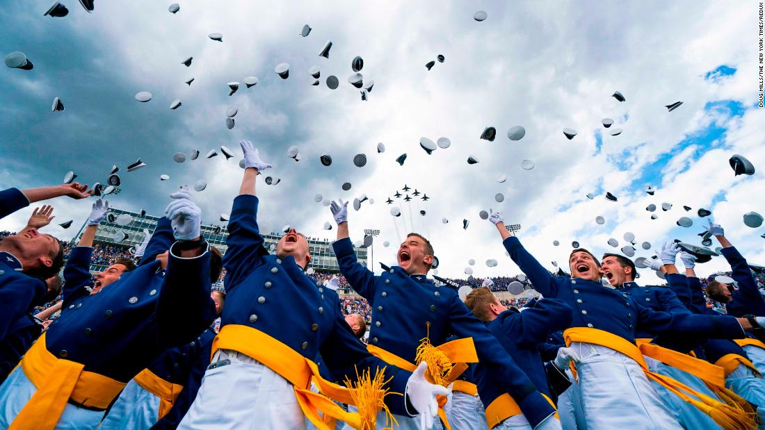 Cadets throw their caps in the air after graduating from the US Air Force Academy on Thursday, May 30.