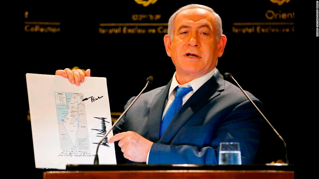 "During a news conference on Thursday, May 30, Israeli Prime Minister Benjamin Netanyahu shows a map of Israel with the Golan Heights. It was signed by US President Donald Trump, he said. Trump also wrote an arrow with the word ""Nice."" Back in March, <a href=""https://www.cnn.com/2019/03/25/politics/donald-trump-benjamin-netanyahu/index.html"" target=""_blank"">Trump signed a proclamation</a> formally recognizing the contested Golan Heights as part of the state of Israel."