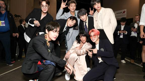 "BTS with US-singer Halsey at the Billboard Music Awards in Las Vegas, where they became the first K-pop group to win Top Group/Duo on May 1, 2019. Halsey features on BTS's single ""Boy With Luv."""