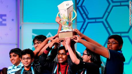 The eight co-champions celebrate after winning the Scripps National Spelling Bee, Friday, May 31, 2019, in Oxon Hill, Md. The spelling bee ended in unprecedented 8-way championship tie after organizers ran out of challenging words.  (AP Photo/Patrick Semansky)