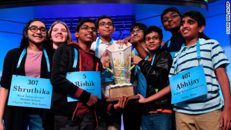 The eight co-champions of the 2019 Scripps National Spelling Bee, from left, Shruthika Padhy, 13, of Cherry Hill, N.J., Erin Howard, 14, of Huntsville, Ala., Rishik Gandhasri, 13, of San Jose, Calif., Christopher Serrao, 13, of Whitehouse Station, N.J., Saketh Sundar, 13, of Clarksville, Md., Sohum Sukhatankar, 13, of Dallas, Texas, Rohan Raja, 13, of Irving, Texas, and Abhijay Kodali, 12, of Flower Mound, Texas, hold the trophy at the end of the competition in Oxon Hill, Md., Friday, May 31, 2019. (AP Photo/Susan Walsh)
