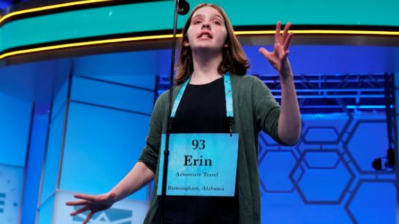Erin Howard, 14, of Huntsville, Alabama, one of eight co-champions, reacts to her final word in the final round.