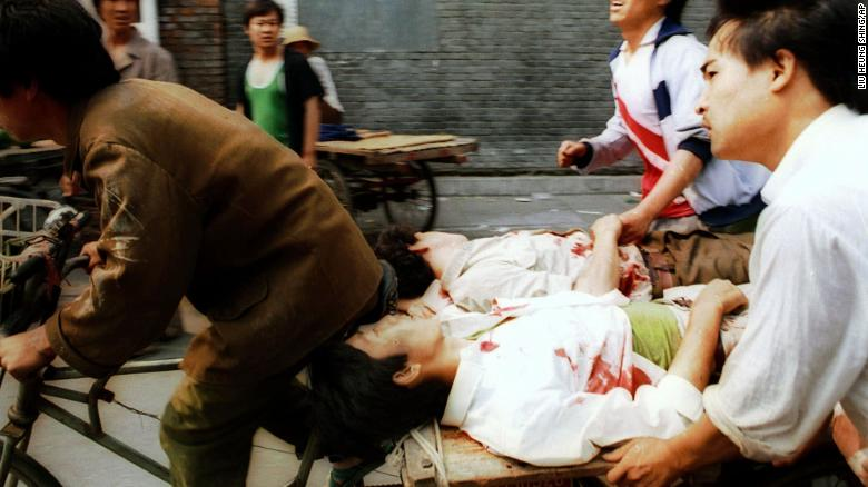 On June 4, a rickshaw driver pedals wounded people, with the help of bystanders, to a nearby hospital in Beijing after they were injured during clashes with Chinese soldiers in Tiananmen Square.