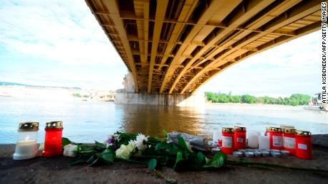 TOPSHOT - Flowers and candles are placed on the banks of the river Danube in Budapest, Hungary, on May 31, 2019, at the spot of a boat accident with seven dead and 21 people still missing, most of them South Korean tourists. - Hopes were fading of finding any more survivors from the boat accident, in which a sightseeing boat overturned after colliding with a much larger river cruise ship on a busy stretch of the Danube on Wednesday evening, May 29, 2019. Police and army boats continued search operations for a second night but their work has been hampered by high river levels and a strong current after weeks of heavy rainfall. (Photo by Attila KISBENEDEK / AFP)        (Photo credit should read ATTILA KISBENEDEK/AFP/Getty Images)