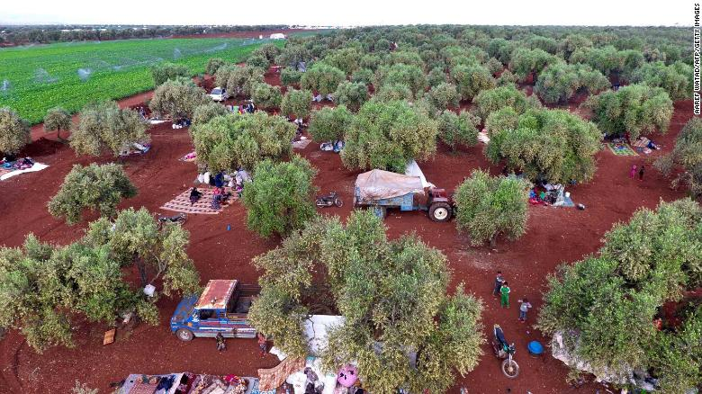Syrians gathering in a field near a camp for displaced people in the village of Atme, Idlib earlier in May.