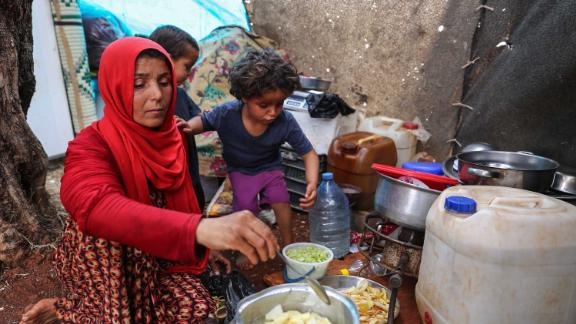 Displaced Syrian mother Mona Mutayr prepares an iftar meal in Atme during the Muslim holy fasting month of Ramadan.