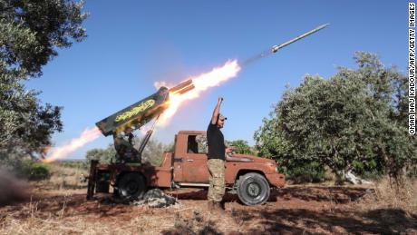 A Syrian fighter from the Turkish-backed National Liberation Front (NLF) fires a heavy artillery gun from the jihadist-held Idlib province against regime positions in the northern part of Hama province, on May 26, 2019. (Photo by OMAR HAJ KADOUR / AFP)        (Photo credit should read OMAR HAJ KADOUR/AFP/Getty Images)