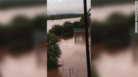 The flooding of the Arkansas River has forced Shelia Clayton and her family from their home.