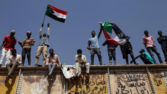 Protesters wave national flags at a sit-in outside the military headquarters in Khartoum on May 2.