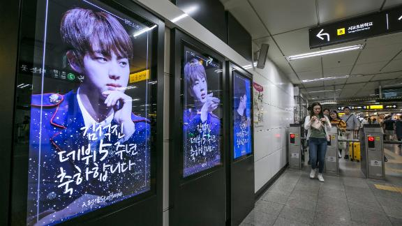Photos of BTS member Kin Seok-jin, better known as Jin, are displayed at a subway station on June 2, 2018 in Seoul, South Korea. Fans often pay for ad space to celebrate the anniversary or birthday of their idol. In this case, they are celebrating Jin
