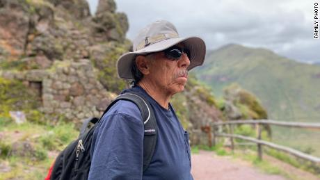 Carlos Valpeoz takes a break from walking around the Pisac Archeological Park. He has been searching for his daughter in Peru since she went missing.