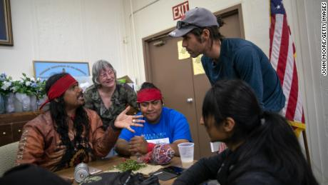 Scott Warren, (R), a volunteer for the humanitarian aid organization No More Deaths, speaks with local residents during a community meeting to discuss federal charges against him for aiding undocumented immigrants on May 10, 2019 in Ajo, Arizona.