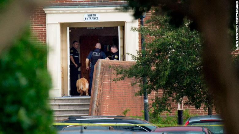 Police respond to a mass shooting Friday at the public works building in Virginia Beach.