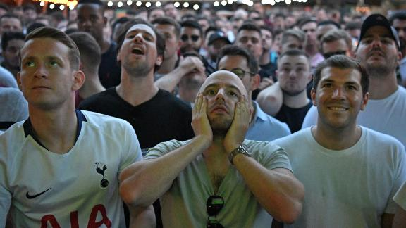 Tottenham supporters in Flat Iron Square in London react as they watch the final.