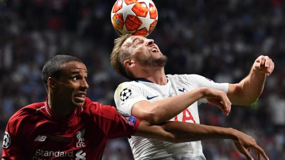 Liverpool defender Joel Matip (L) and Tottenham Hotspur striker Harry Kane battled for the ball. Kane made his first appearance in 55 days, after an injury sustained in the Champions League quarterfinal.