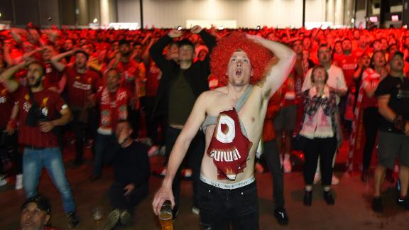 Liverpool supporters in the M&S Bank Arena in Liverpool react to Salah
