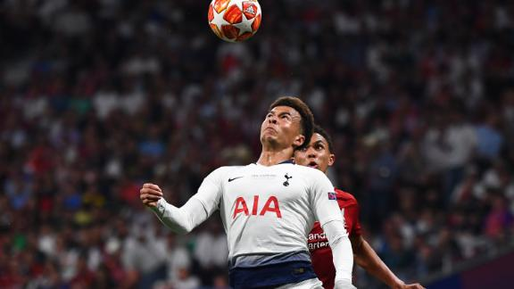 Tottenham Hotspur midfielder Dele Alli (L) vies with Liverpool defender Trent Alexander-Arnold.