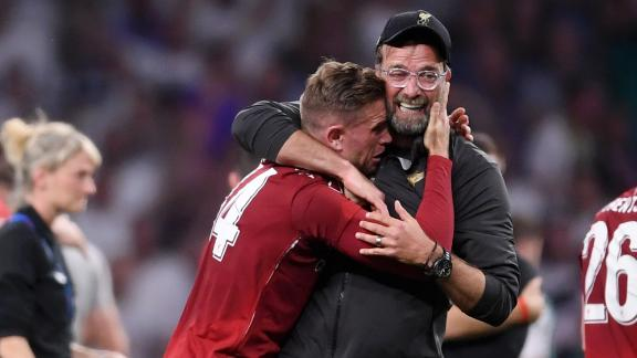 Liverpool captain Jordan Henderson of Liverpool celebrates with manager Jurgen Klopp at the final whistle.