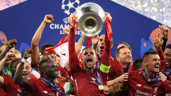 Jordan Henderson of Liverpool lifts the Champions League trophy after beating Tottenham Hotspur in Madrid on Saturday.