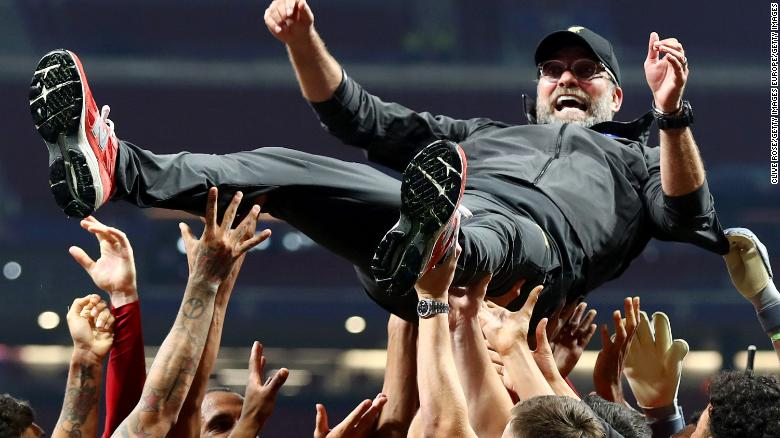 Liverpool manager Jurgen Klopp is thrown in the air as he celebrates with his players and staff after winning the Champions League final against Tottenham Hotspur in Madrid on Saturday.