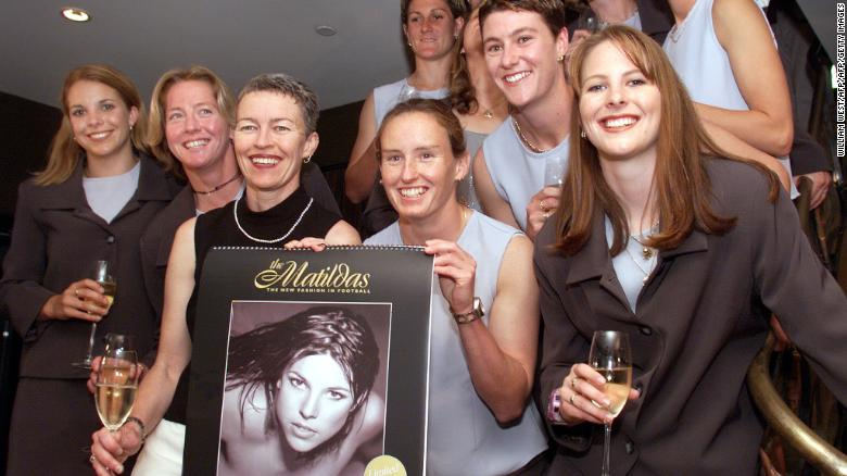 Australia's women's football team poses with a nude calendar produced to promote women's soccer in Australia in Sydney in November 1999.