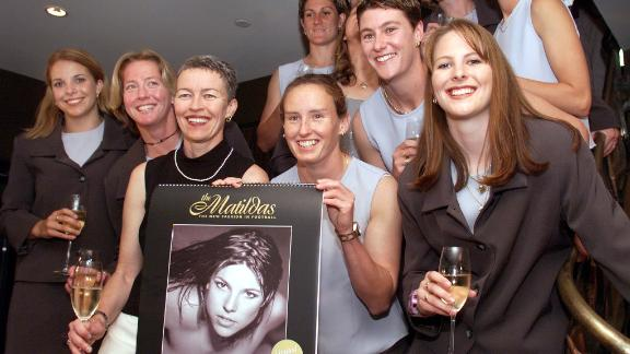Australia's women's soccer team poses with a nude calendar produced to promote women's football