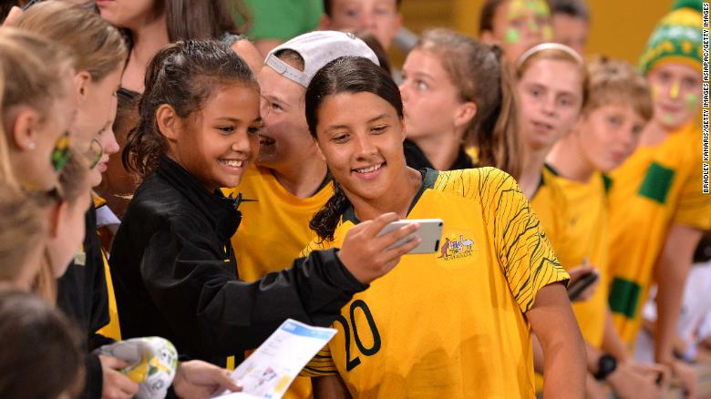 Sam Kerr of Australia gets a selfie taken with a young fan after the 2019 Cup of Nations match between Australia and the Korea Republic at Suncorp Stadium on March 3, 2019 in Brisbane.