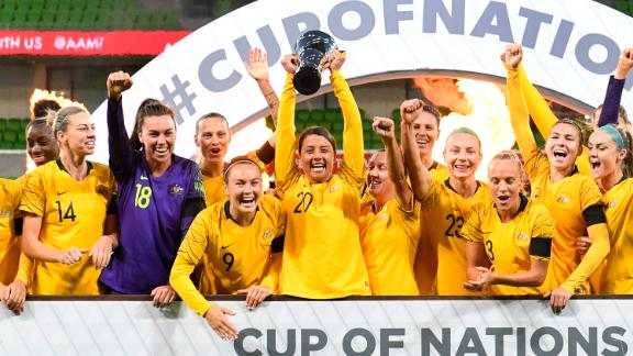 Australia celebrate with the trophy after defeating Argentina in their Women