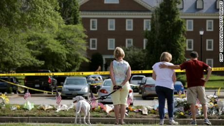 VIRGINIA BEACH, VIRGINIA - JUNE 02: People stop to pay their respects to those killed in a mass shooting at a makeshift memorial outside the City of Virginia Beach Operations Building June 02, 2019 in Virginia Beach, Virginia. Eleven city employees and one private contractor were shot to death Friday in the operations building by engineer DeWayne Craddock who had worked for the city for 15 years. (Photo by Chip Somodevilla/Getty Images)