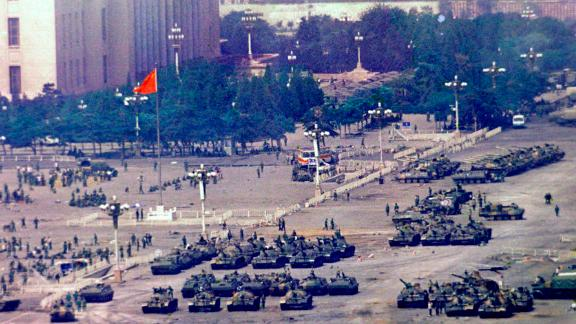 Chinese troops and tanks gather in Beijing, one day after the military crackdown.