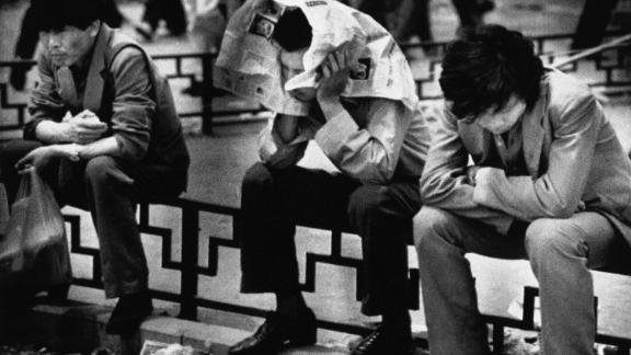 Beijing University students endure the boredom of their sit-in at Tiananmen Square in May 1989.
