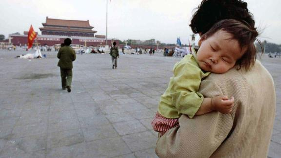 A child sleeps on his mother