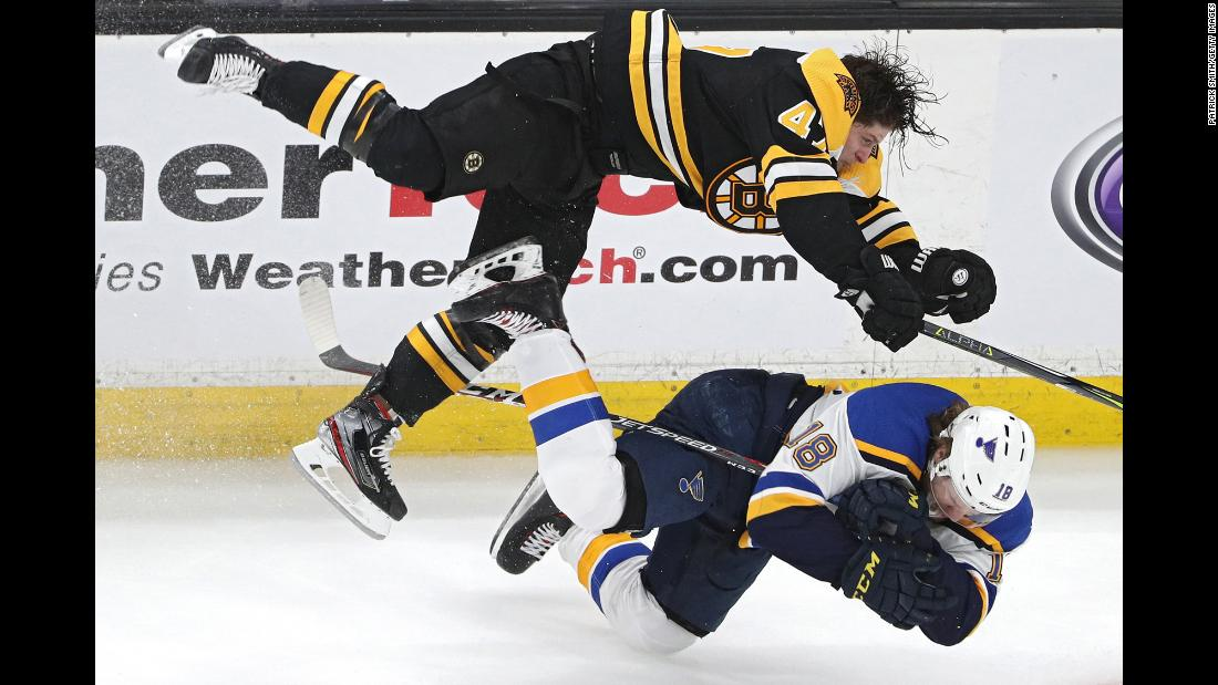 Torey Krug of the Boston Bruins checks Robert Thomas of the St. Louis Blues during the third period of Game 1 of the Stanley Cup Final at TD Garden on Monday, May 27.