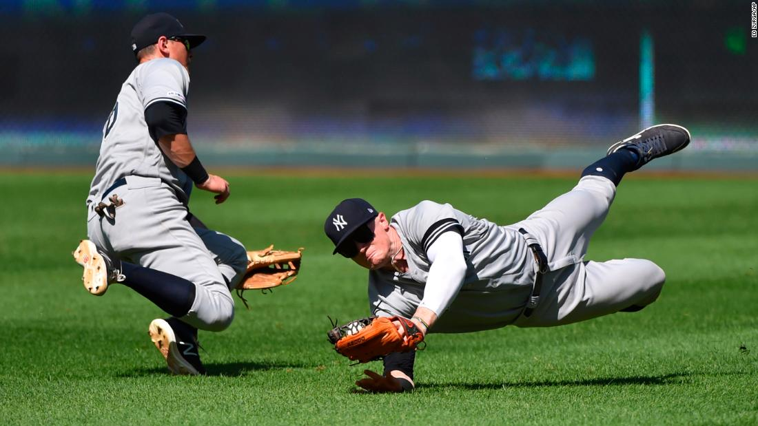 New York Yankees right fielder Clint Frazier, right, avoids a collision with second baseman DJ LeMahieu as he catches a ball during the ninth inning of a baseball game against the Kansas City Royals in Kansas City, Missouri, on May 26.