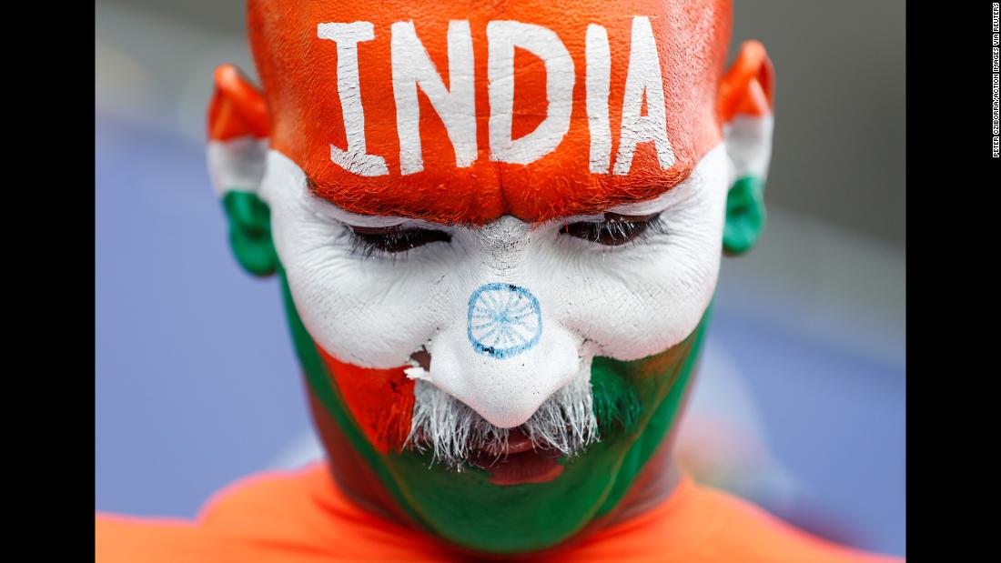 A fan, with his face painted like the Indian flag, looks on during a Cricket World Cup match between Bangladesh and India in Cardiff, England, on Tuesday, May 28.
