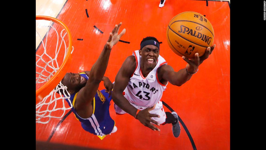 Pascal Siakam of the Toronto Raptors drives to the basket while being defended during Game 1 of the NBA Finals in Toronto on Thursday, May 30. Siakam shot 82.4% from the field and finished with a team-leading 32 points.