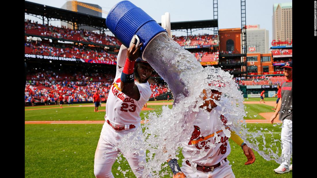 Marcell Ozuna of the St. Louis Cardinals douses teammate Kolten Wong after defeating the Chicago Cubs at Busch Stadium in St. Louis on Sunday, June 2.