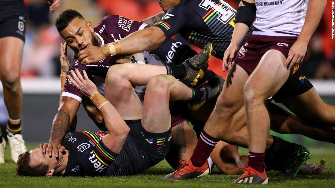 Addin Fonua-Blake of the Sea Eagles, center left, is tackled during the round 12 NRL match between the Penrith Panthers and the Manly Warringah Sea Eagles at Panthers Stadium in Sydney, Australia, on May 30.