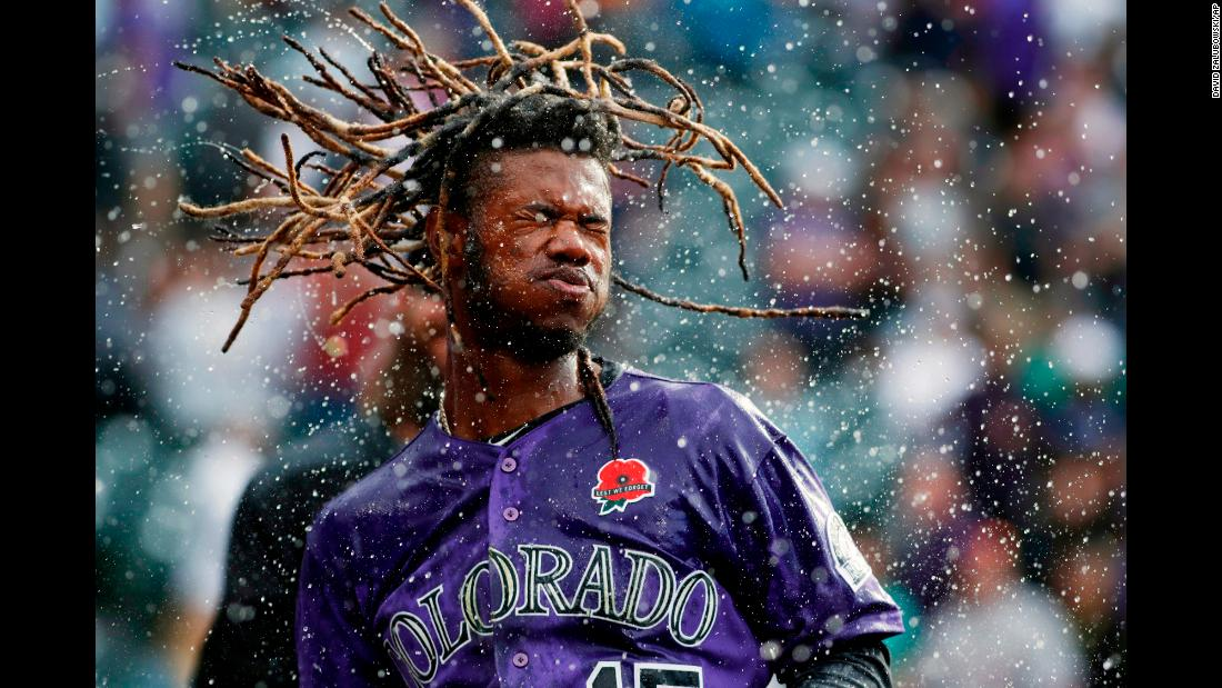 Colorado Rockies player Raimel Tapia shakes water from his head after being doused in celebration of his 11th inning walk-off single against the Arizona Diamondbacks in Denver, Colorado, on Monday, May 27. The Rockies won 4-3.