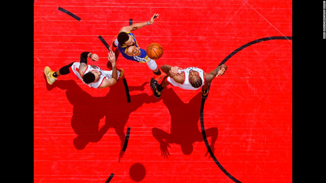 Stephen Curry of the Golden State Warriors shoots over Kawhi Leonard of the Toronto Raptors during Game 1 of the NBA Finals at Scotiabank Arena in Toronto on May 30.