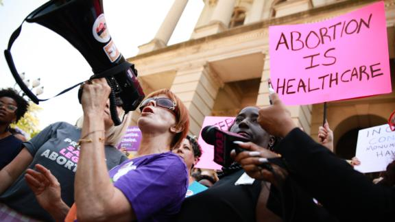"""ATLANTA, GA - MAY 21: Actress Frances Fisher, of the upcoming HBO TV series 'Watchmen', and 'Titanic', speaks during a protest against recently passed abortion ban bills at the Georgia State Capitol building, on May 21, 2019 in Atlanta, Georgia. The Georgia """"heartbeat"""" bill would ban abortion when a fetal heartbeat is detected. The Alabama abortion law, signed by Gov. Kay Ivey last week, includes no exceptions for cases of rape and incest, outlawing all abortions except when necessary to prevent serious health problems for the woman. Though women are exempt from criminal and civil liability, the new law punishes doctors for performing an abortion, making the procedure a Class A felony punishable by up to 99 years in prison. (Photo by Elijah Nouvelage/Getty Images)"""