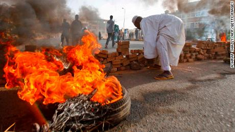 Sudanese protesters close Street 60 with burning tyres and pavers as military forces tried to disperse the sit-in outside Khartoum's army headquarters on June 3, 2019. - At least two people were killed Monday as Sudan's military council tried to break up a sit-in outside Khartoum's army headquarters, a doctors' committee said as gunfire was heard from the protest site. (Photo by ASHRAF SHAZLY / AFP)        (Photo credit should read ASHRAF SHAZLY/AFP/Getty Images)