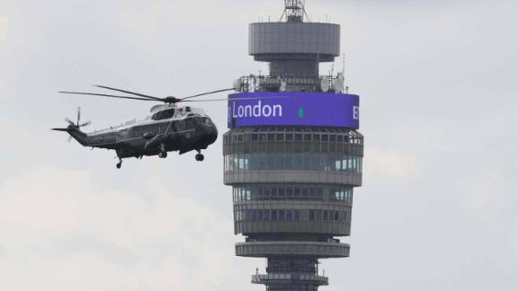 Marine One flies past the BT Tower in London.