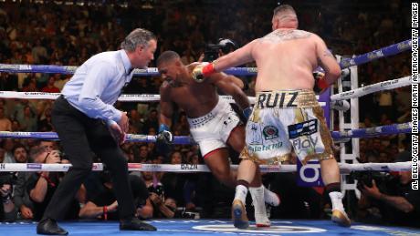 Andy Ruiz Jr. knocks down Anthony Joshua in the third round in New York.