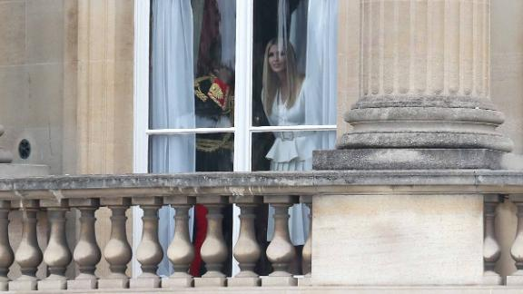 Trump's daughter Ivanka, who is also advisor to the President, looks out of a window at Buckingham Palace.