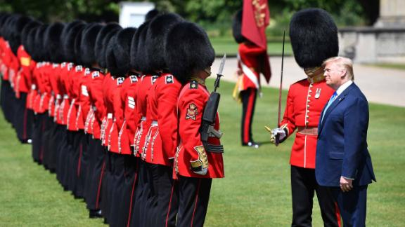 Trump inspects a guard of honor at Buckingham Palace.